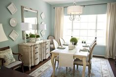 I'm thinking of changing my dining room to look something like this.. Going for a cool look for a change.