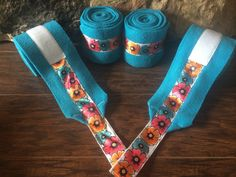 Turquoise polo wraps with floral ribbon trim