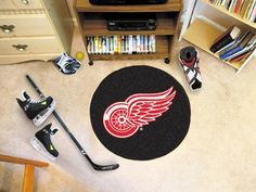 Detroit Red Wings Hockey Puck Mat $21.95 RJ would love it.
