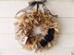 Hey, I found this really awesome Etsy listing at http://www.etsy.com/listing/105127921/burlap-wreath-tan-with-black-roses