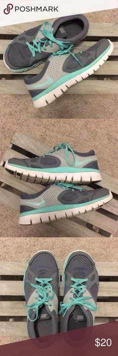 Gray and teal Nike Running shoes Super cute Nike Running shoes in amazing used condition. Gray and teal with white bottoms. I just never wear them and am cleaning out my closet. Nike Shoes Athletic Shoes