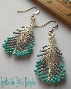 Beadwork Feather Earrings ... Grey and Robin's Egg Blue. $18.00, via Etsy. Turquoise is one of my favourite colours. by SAburns