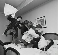The Beatles -- from left, Paul McCartney, John Lennon, Ringo Starr and George Harrison -- letting off steam with a pillow fight. Harry Benson, Ringo Starr, George Harrison, Paul Mccartney, John Lennon, Pop Rock, Rock And Roll, Great Bands, Rock Music