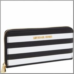 MK Striped Wallet Michael Kors black and white striped wallet. Gold hardware. Never used. Michael Kors Bags Wallets