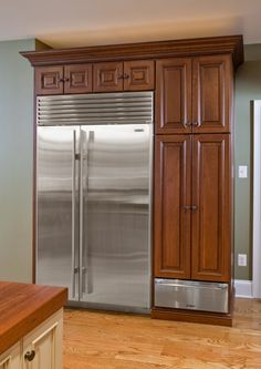 Sub Zero refrigeration is something any custom kitchen design seems to require. A built-in warming drawer was added under the tall storage cabinet.