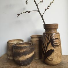 Some nice vintage West German pottery! Make a statement with a group of matching vases or just place this unique Schreurich vase on its own. - by ChrisVintageStyle