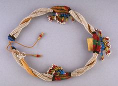 Twisted collar with bead fringe - Date: 19th century Location: Not on display Century: 19th Century AD - Media: Beads Dimensions: 18 1/2 (47 cm) Dept Africa, Oceania, and the Americas - Object Type: Costume Accessory - Country: South Africa - Continent: Africa Culture/People: Zulu -  Provenance: Collected by the donor's great-uncle, James Waldie, in South Africa between 1893 and 1902. Waldie was a paymaster in the British Army.
