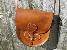 Check out this item in my Etsy shop https://www.etsy.com/uk/listing/511489752/handmade-small-leather-shoulder-bag