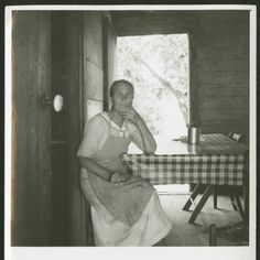 Grandmother of 14 children and 56 grandchildren sitting at kitchen table, near Chesnee, S.C. (Farm Security Administration, Dorothea Lange, photographer) 1937