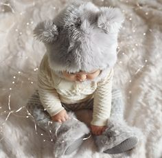 Luxe Faux Fur Baby Animal Hoods and booties! I couldn't help myself had to order for our little M!