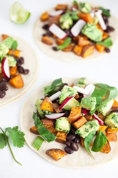 A fresh and healthy taco recipe that's full of lightly spiced sweet potato and topped with a light and refreshing avocado salsa.