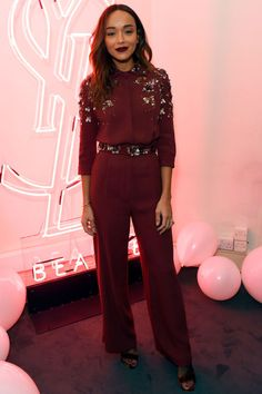 1 December British actress, Ashley Madekwe attended a YSL Beauty Club event wearing an embellished wine jumpsuit and a dark berry lip.