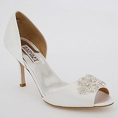 Low heel (more comfy), classy - just hope the heel wouldn't poke through the grass