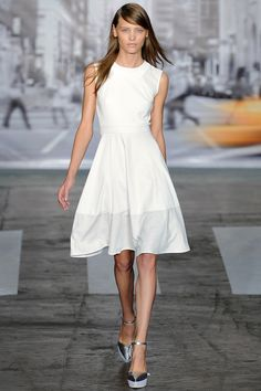 Hint of athleticism in the mesh touches of this very on-trend white frock. #dkny #nyfw #spring2013