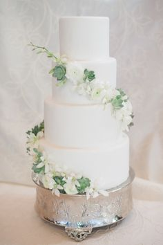 Pretty White Wedding Cake with Flower Garland | photography by http://www.kateholstein.com
