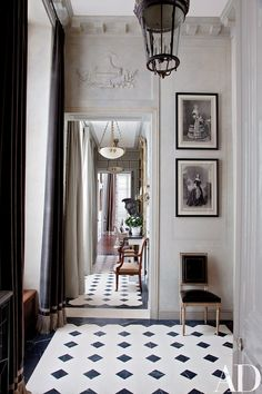Curtained in a Romo velvet, a light-filled entrance hall greets visitors at a Paris apartment renovated and decorated by Jean-Louis Deniot.
