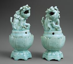 Pair of incense burners, Yuan dynasty (1271–1368), ca. early 14th century; Qingbai ware  China, Probably from kilns in the vicinity of Jingdezhen, Jiangxi Province, Porcelain with brown, low- and full-relief decoration under bluish white glaze    http://www.metmuseum.org/toah/works-of-art/34.113.2,3