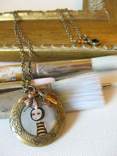 A Make It favourite. Bee Girl antique locket made by painter by A Cagey Bee #MakeItEdmonton #MakeItVancouver
