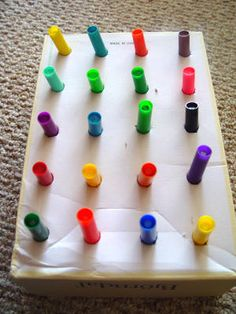 Take some scissors and punch holes in the bottom of the box. Take a marker and push it through each hole. After you have created all the holes and put the markers in, let your toddler have fun taking them out and putting them back in again. Talk about the colors and try to match them up!