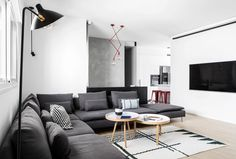 """Tel Aviv-based designer Yael Perry renovated this apartment in the Israeli region of Sharon into a """"cool, contemporary"""" space with unexpected colourful accents."""