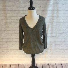 💋HP💋Banana Republic V-Neck Sweater Dark grey sweater with a deep V neck! Looks amazing with a black or white button down shirt under it. So versatile and come comfortable! Banana Republic Sweaters V-Necks