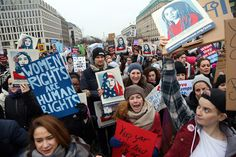 In Berlin, Germany, predominantly women demonstrate in front of the United States Embassy and Brandenburg Gate one day after the inauguration of U.S. President Donald Trump on January 21, 2017