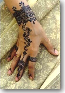 Beautiful mehndi, but really don't like the black things near the nails..it detracts from the overall beauty.