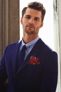 blue blazer. blue knit tie. light blue oxford. red pocket square.  classic. sleek. style.
