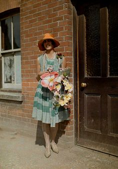 A woman by a door for the Alexandra Day Event 1928.
