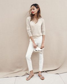 J.Crew women's iridescent shimmer V-neck sweater, Martie pant, thin hoop earrings and crackled gold foil clutch.