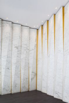 New York studio GRT Architects has repaired the decorative facade of a tower in the city's Garment District, during the renovation of its entrance. Cladding Design, Stone Cladding, Wall Cladding, Facade Design, Door Design, Wall Design, Marble House, Marble Wall, Interior Walls