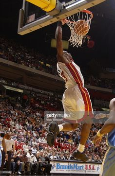 3c858c579e6c Dwyane Wade  3 of the Miami Heat dunks against the Denver Nuggets during NBA  action