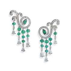 La Esmeralda Emerald Earrings  -  La Esmeralda series is inspired by the ballet of the French and Russian choreographer Marius Petipa ballet, which was re-staged for the Russian Ballet in Saint Petersburg. This spectacular ring with musical and arabesques lines combines colour gemstones of exceptional quality. This piece is set in platinum and features round white diamonds and pear emeralds.