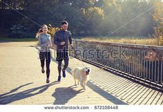 happy couple with dog running outdoors by dolgachov. fitness, sport, people and jogging concept – happy couple with dog running outdoors Happy Couple Quotes, Couple Running, Running Tips, Running Buddies, Dog Runs, Sports Photos, Olympians, Couple Goals, Jogging
