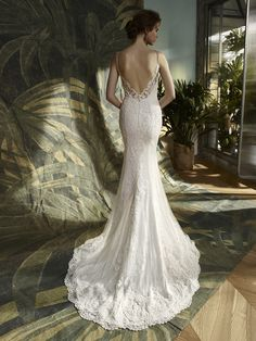 Kamryn: Sweet and sexy rolled into one gorgeous gown: this full-length, overlace and tulle mermaid style features a classic sweetheart neckline framed by delicate beaded spaghetti straps and beaded lace. A low V-back is a striking and alluring finish above an invisible zipper closure.