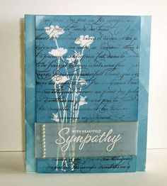 handmade card: Marina Mist Sympathy by jemur ... blue base brayered on ... with silhouette flowers ... French Script background stamp on top of it all ... vellum band with sentiment on top of main layer ... lovely ...