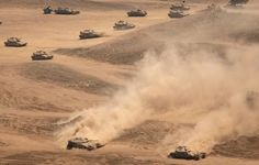 Merkava Mk 4 tanks during maneuvers. Two vehicles on the bottom of the photo are equipped in anti-mine devices
