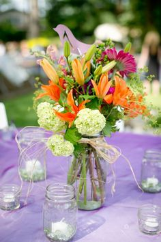 Freshly picked, or so you think! :  wedding centerpieces flowers green mason jars orange outdoor wedding pink plum purple reception  DSC7685
