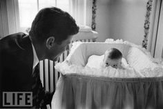 Peek-A-Boo: Photo by Ed Clark, 1958  So much is unseen in this photo -- Kennedy's face, baby Caroline's mouth -- and yet we not only know exactly what's happening but can feel the father-daughter bond as if we were in the room.