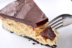 What's better than a BOOZY cheesecake with chocolate ganache. We think nothing.  Get the recipe at Life's Ambrosia   - Delish.com
