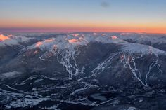 Whistler and Blackcomb mountains painted to the base in snow and lit with alpenglow. Photo Taken Dec 14, 2015. Come celebrate winter with us: http://www.whistlerblackcomb.com/purchase/deals-packages Photo: @megatront