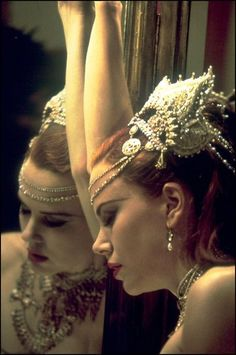 Moulin Rouge - reminds me of the exhaustion that I have right before I get severely depressed at any given time. It's a reminder that I'm beautiful and wonderful enough to not stay behind the curtain, but to get out and make the show go on.