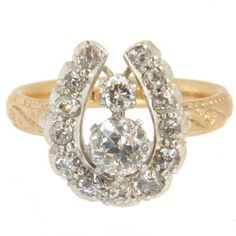 Antique diamond ring. An Old Brilliant Cut Diamond Horse Shoe Ring Engagement ring. Diamonds 1.25cts approx.