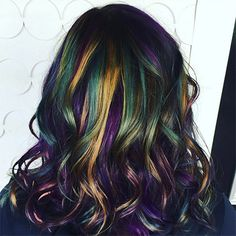 Here's the thing about mermaid hair: It requires a light base or a willingness to spend a lot of quality time with bleach. Fortunately, a few months ago, a cohort of dark-haired color enthusiasts decided to create their own...