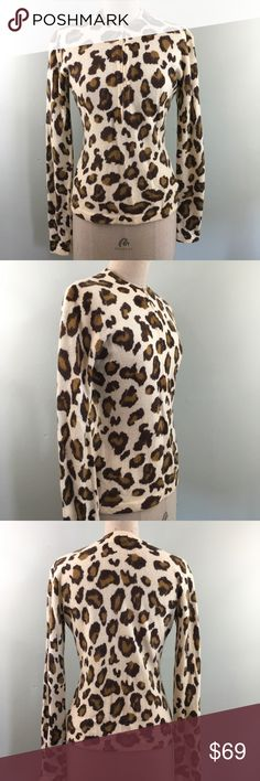 """Vintage 80s or 90s // Guess USA // Leopard Sweater Vintage Guess Jeans U.S.A. half-zip front sweater from either the 1980's or 1990's (I couldn't find information on google about which decade this label is from). Wish this still fit me!  Pre-loved in fair condition. This item is sold AS IS, please note there are some small moth holes and may be a spot or two.  Size Large Approximate Measurements: Bust 37-38"""" Waist 29-34"""" Sleeve Length 27"""" Torso Length 24""""  Please let me know if you have…"""