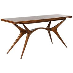Caviuna Rosewood Console/Dining Table by Giuseppe Scapinelli   From a unique collection of antique and modern dining room tables at http://www.1stdibs.com/furniture/tables/dining-room-tables/