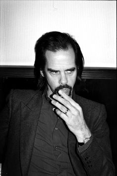 """Nick Cave, when asked why he kicks Warren Ellis on stage, """"Um, I have to move Warren along a little bit. He gets into the moment for… extended periods. And I'm like, come on… So, yeah, I kick him along. I kick him more in Grinderman than in the Bad Seeds."""""""
