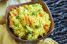 Wali Wa Nazi (Coconut Rice) is popular in Tanzania and surrounding East African countries. This particular version, Wali Wa Junde Na Karoit (Tanzanian Coconut Rice with Peas and Carrots) is dyedye…
