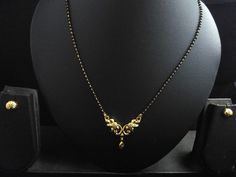 22k gold plated traditional flower mangalsutra with balck beads double chian