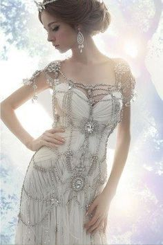 Incredible jeweled wedding dress - 12 Steampunk Wedding Dresses - the dress looks simple, yet the jewels and beading give it more piazza Mode Steampunk, Steampunk Fashion, Victorian Steampunk, Gothic Fashion, Crystal Wedding Dresses, Wedding Gowns, Crystal Dress, Bridal Gowns, Wedding Dresses With Bling